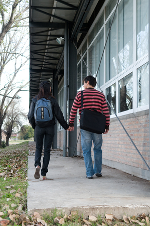 20 to 25 years old: Couple in love walking outside
