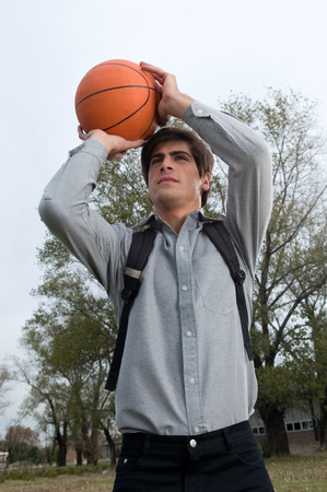 20 to 25 years old: Man playing basketball