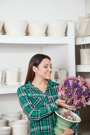 woman buying: Woman buying a pottery Stock Photo