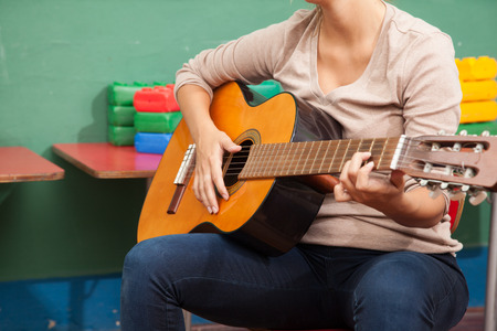 20 25 years old: Teacher playing guitar