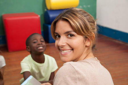 3 year old boy: Teacher smiling at camera Stock Photo