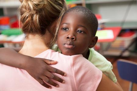 African boy hugging his teacher