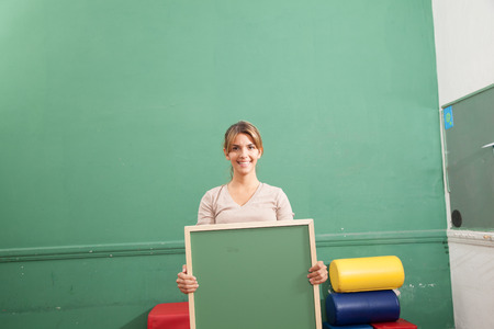 20 25 years: teacher holding a blackboard Stock Photo