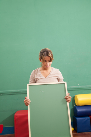 20 to 25 years old: Teacher holding a blackboard