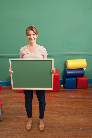 20 25 years: Woman holding a blackboard Stock Photo