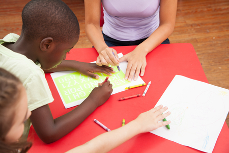 20 to 25 years old: Black boy drawing in the kindergarden