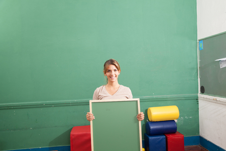 25 years old: Woman holding a blackboard Stock Photo