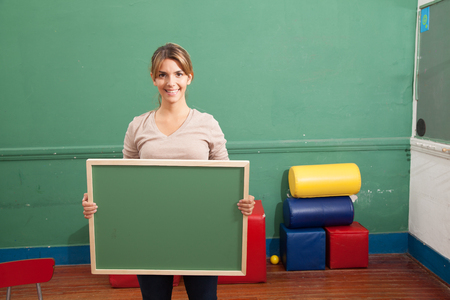 20 25 years: Teacher holding blackboard