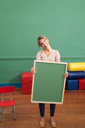 20 25 years old: Teacher holding a blackboard