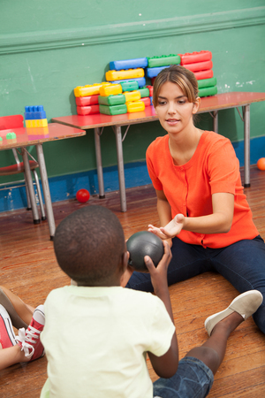20 to 25 years old: Teacher playing with black student