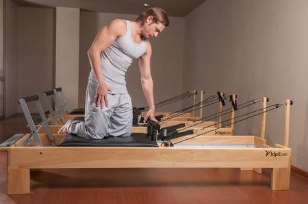 healthier: Man doing pilates Stock Photo
