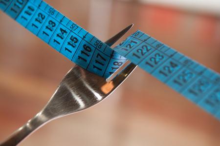 centimeter: fork and centimeter Stock Photo