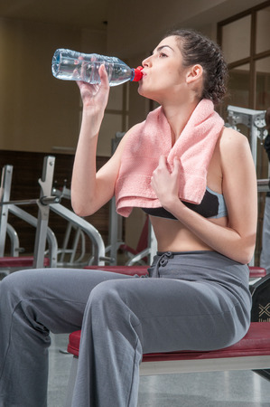 20 30 years: Woman drinking water after exercising