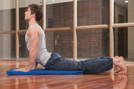 20 30 years: Man doing yoga