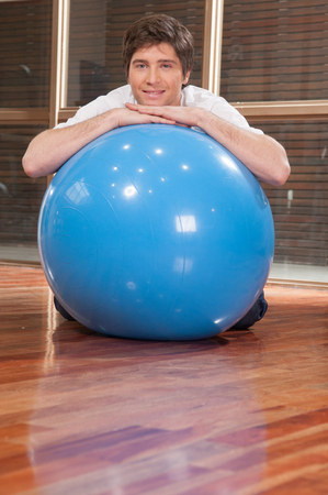 20 30 years: Man playing with a blue ball Stock Photo