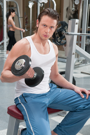 20 30 years: Man doing weights