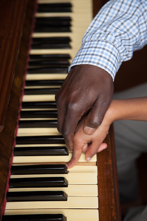 Father and Daughter playing piano together