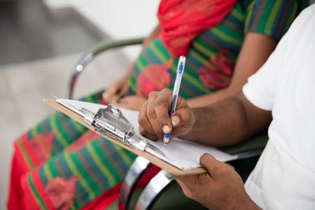 Hindu couple writing a model in hospital