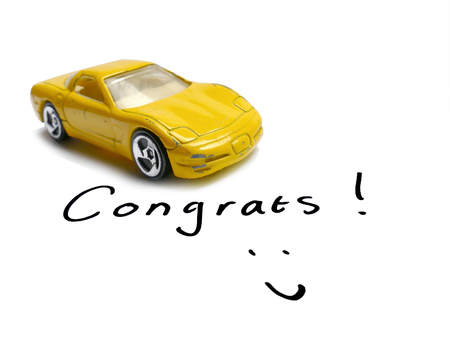 drivers: Congratulations Drivers License with old toy car model