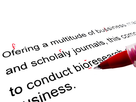 english text: Red pen correcting proofread english text Stock Photo