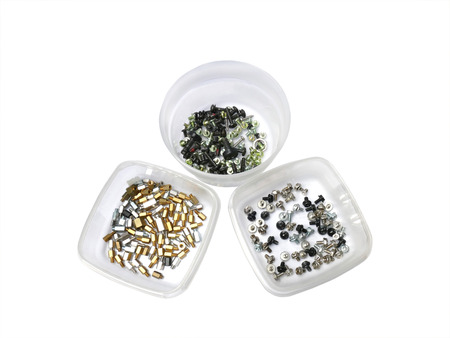 standoff: Three semi transparent containers with assorted computer screws on white Stock Photo