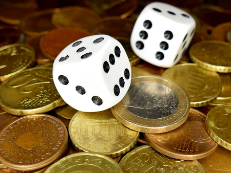 odds: Dice and European coins money full screen, gambling concept Stock Photo