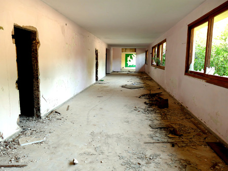 Remains of deserted Saladi beach resort in Peloponnese. A former hotel for nudists, closed under pressure of the church. Corridor view with debris.