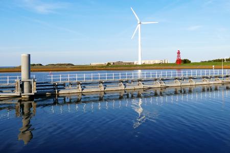 Windmill, sluice and lighthouse on Oostkade van Den Oever, Wieringen Afsluitdijk The Netherlands