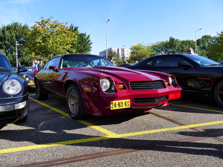 Amsterdam, The Netherlands - September 10, 2016: Second generation Maroon red Chevrolet Camaro Z28 1981 on display during Cars & Coffee XXL show . Non-ticketed public event held in the streets of the city with people carspotting.
