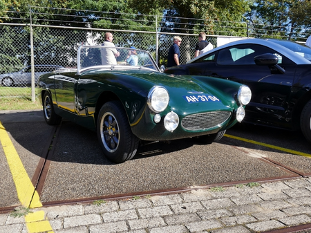 mk: Amsterdam, The Netherlands - September 10, 2016: Green Austin Healey Sprite Mk 11 1964 on display during Cars & Coffee XXL show. Non-ticketed public event held in the streets of the city with people carspotting. Editorial