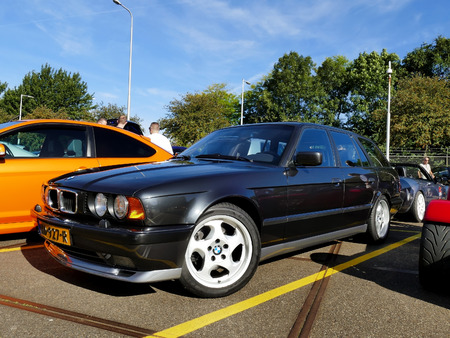 Amsterdam, The Netherlands - September 10, 2016: Black BMW M5 E34 Touring 1994 on display during Cars & Coffee XXL show. Non-ticketed public event held in the streets of the city with people carspotting.