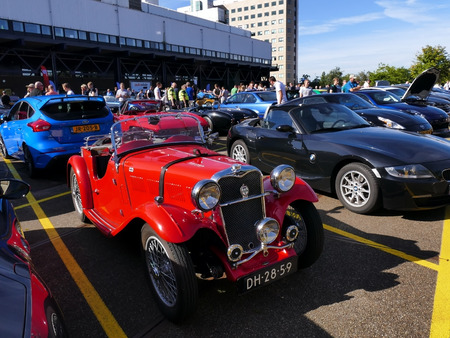 Amsterdam, The Netherlands - September 10, 2016: Red Singer Le Mans Special Speed 1935 on display during Cars & Coffee XXL show. Non-ticketed public event held in the streets of the city with people carspotting. Editorial