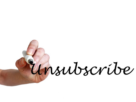 unsubscribe: Hand writing Unsubscribe with black marker on transparent whiteboard Stock Photo