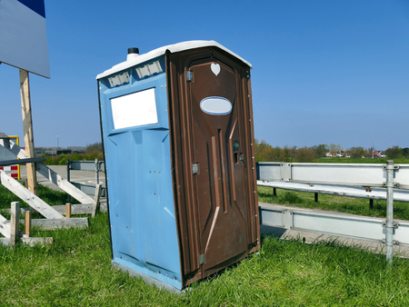 Transportable modern designed portable public street toilet is placed at building site, outdoor privacy Stock Photo