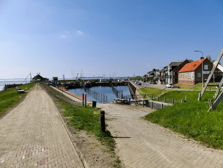Ouddorp, The Netherlands - April 9, 2017: Old little harbor scenery at Ouddorp on a sunny day, Goeree overflakkee Editorial