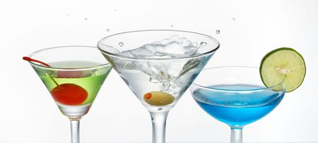 martini splash: three glass of cocktail with martini splash