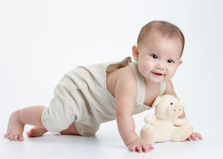 baby play: cute little baby play alone, studio shot Stock Photo