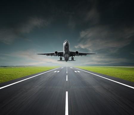 aeroplane departing or landing at the airport