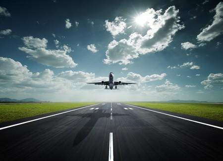 depart: aeroplane at the airport with good weather Stock Photo