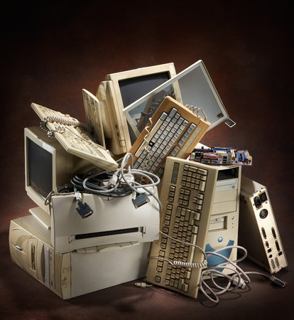 used: stack of old and obsolete computer equipment Stock Photo