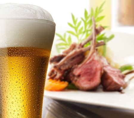 lamb meat: glass of beer with delicious lamb rack