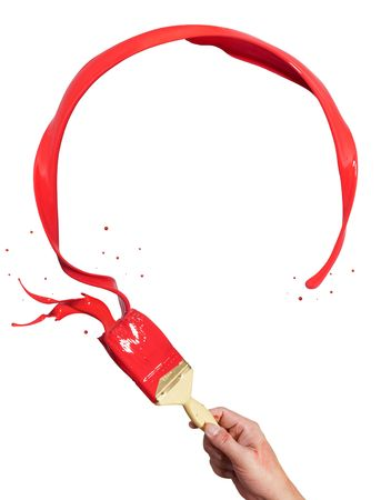 hand holding paintbrush creating circle red paint splash with copy space Stock Photo