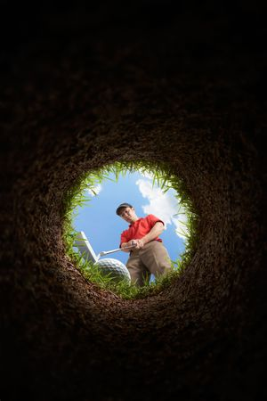 golf hole: golfer putting, view from inside the hole