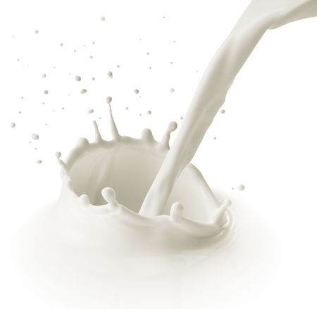 milk drop: pouring milk or white liquid created splash