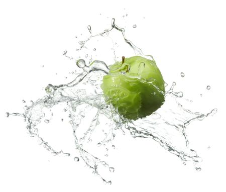 green apple: fresh green apple with water splash on white background Stock Photo