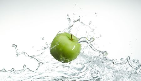 water level: fresh green apple on water level with splash Stock Photo