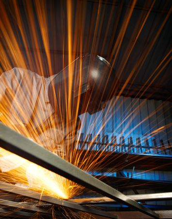 grinding: man grinding in workshop with beautiful sparks Stock Photo