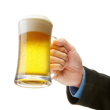 hand of a businessman holding a beer toasting Stock Photo - 6960130