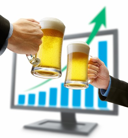 beer toasting in front of monitor showing success Stock Photo - 6960157
