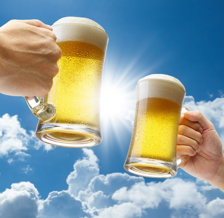 sun glasses: toasting with beers against clear blue sky